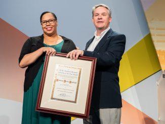 Kaetrena Davis Kendrick receiving the 2019 Academic/ Research Librarian of the Year award